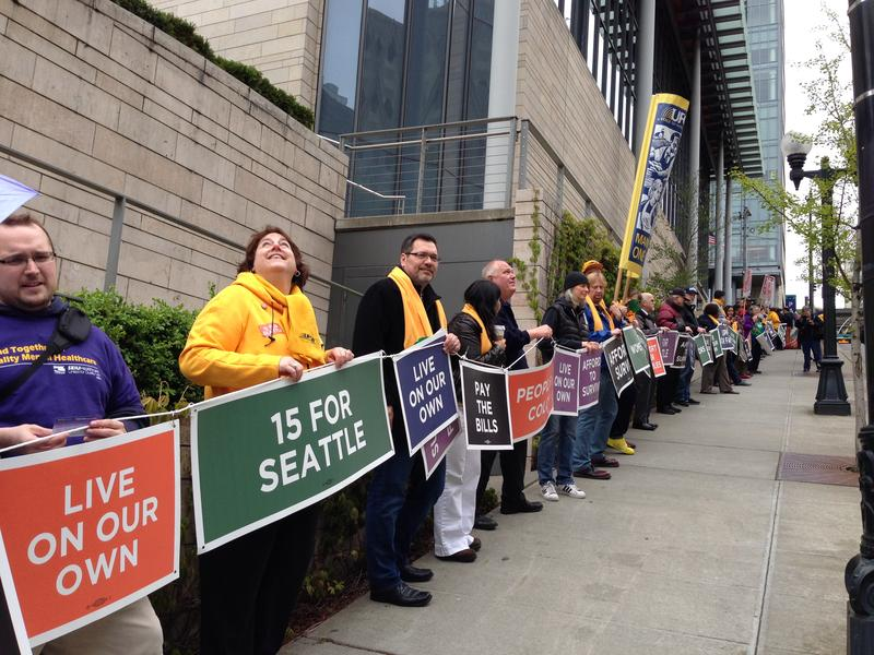 Demonstrators in Seattle form a human chain around City Hall in support of a $15 minimum wage in April 2014.
