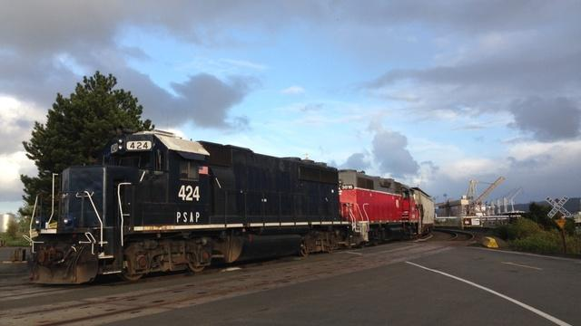 A freight train travels through Hoquiam, Wash. Trains could be arriving with oil tankers if proposed oil terminals are built on Grays Harbor.