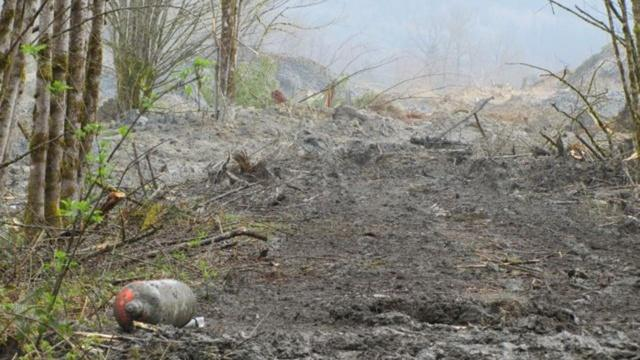 Propane tanks floated to the surface of the massive landslide debris field that engulfed 42 homes near Oso, Wash.