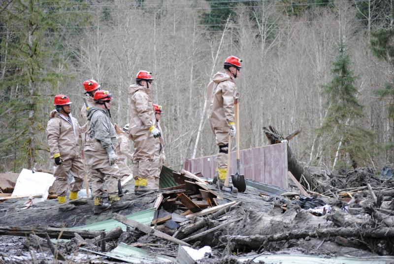 Members of the National Guard Assist with search and rescue operations at the site of the mudslide near Oso.