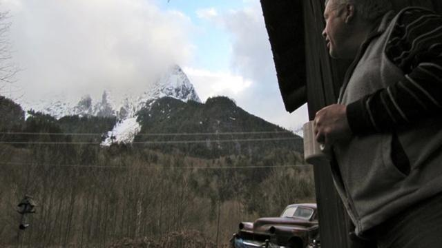 """""""Maybe that hillside is a danger to me,"""" says Ben Van Dusen, looking towards the steep foothills of Mt. Index less than a 1/4 mile from his home. """"I didn't think it was but maybe it is."""""""