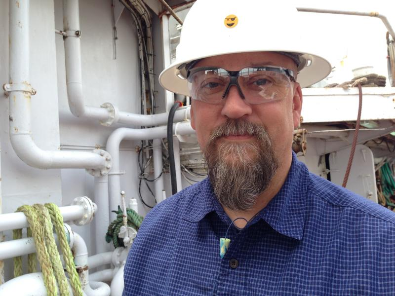 Alan Davis, Safety and Compliance Director for American Seafoods of Seattle, on the deck of the Nothern Eagle