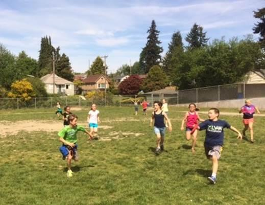 Fourth-graders at Schmitz Park Elementary in West Seattle play capture the flag in their outdoor P.E. class.