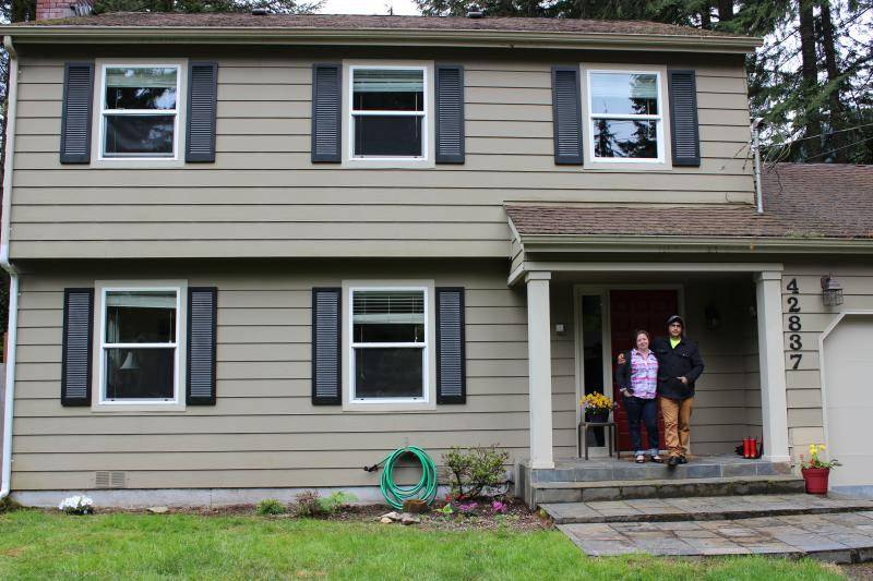 Andrea VanHorn and her fiancee outside their three-bedroom home in North Bend, which she said is a lot more affordable than living in Seattle.