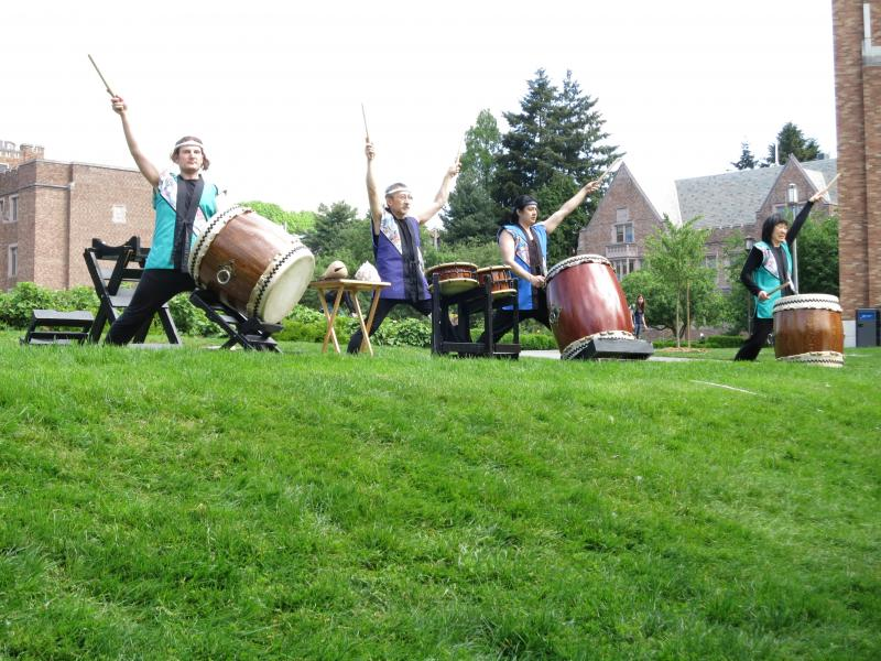 Members of Seattle Kokon Taiko perform at a dedication ceremony for 18 new cherry trees given to the University of Washington from Japan.