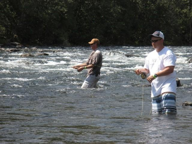 Sgt. Kurt Erickson and SSG. James Butler wade fishing in the Naches River while on a Rivers of Recovery trip.