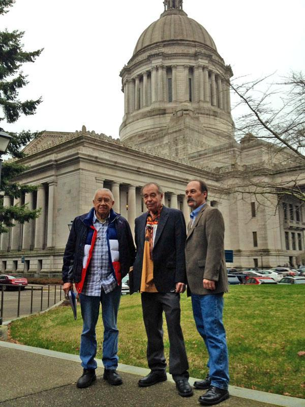 Billy Frank, Jr., a veteran of the fish wars, Hank Adams, a tribal advocate, and Shawn Yanity, chairman of the Stillaguamish Tribe confer in Olympia in January.
