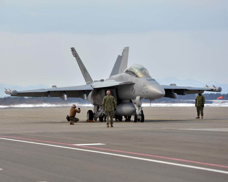 Sailors and Pilots Prepare to Launch an EA-18G Growler.