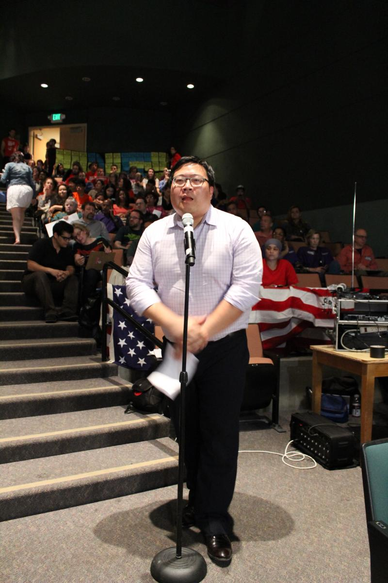 Ron Oh speaks at Seattle City Council's public hearing on minimum wage on May 13.
