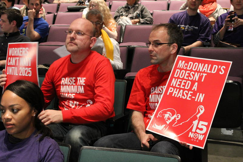 Supporters of the group 15 Now attend a Seattle City Council public meeting to discuss minimum wage on May 13.