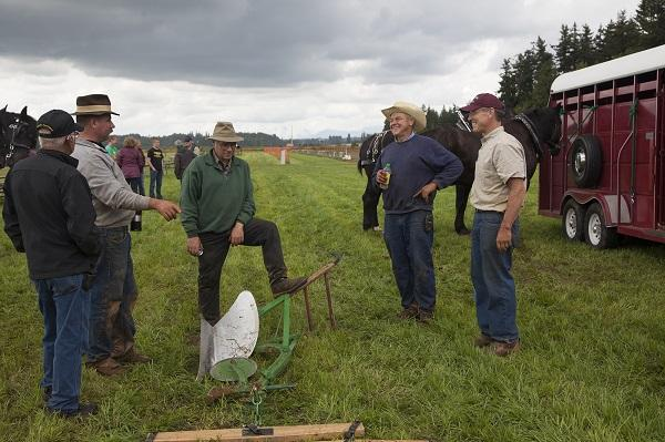 George Bowen of Custer, right, talks with Duane Van Dyk, Gerry Lee and Tim Bielenburg, three plowmen from Oregon, after competing in the 2013 International Plowing Match in Lynden.