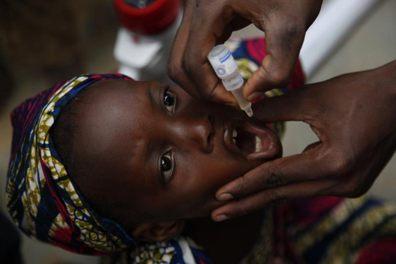 A child receives an oral polio vaccine in Nigeria.