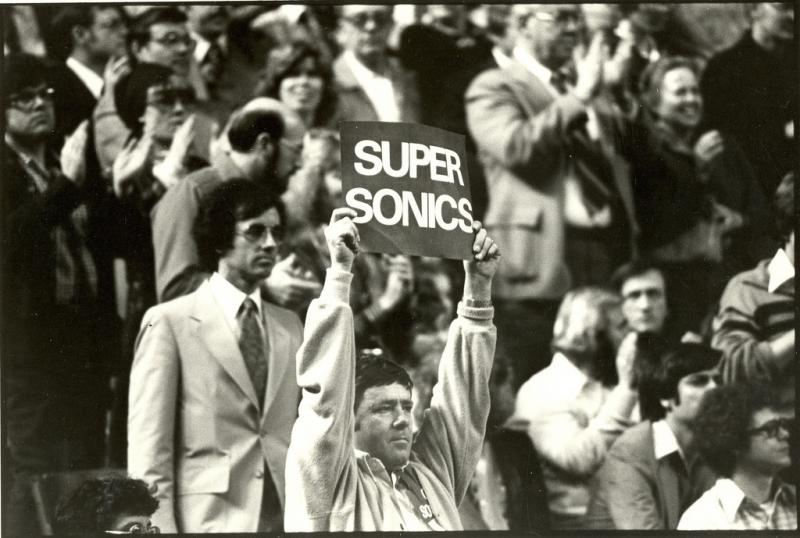 Seattle Sonics fan with sign, circa 1980, the year after the team won the NBA championship.