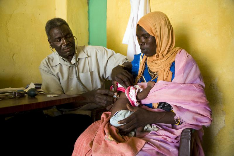 A refugee from the Darfur conflict visits a medical facility in Sudan.