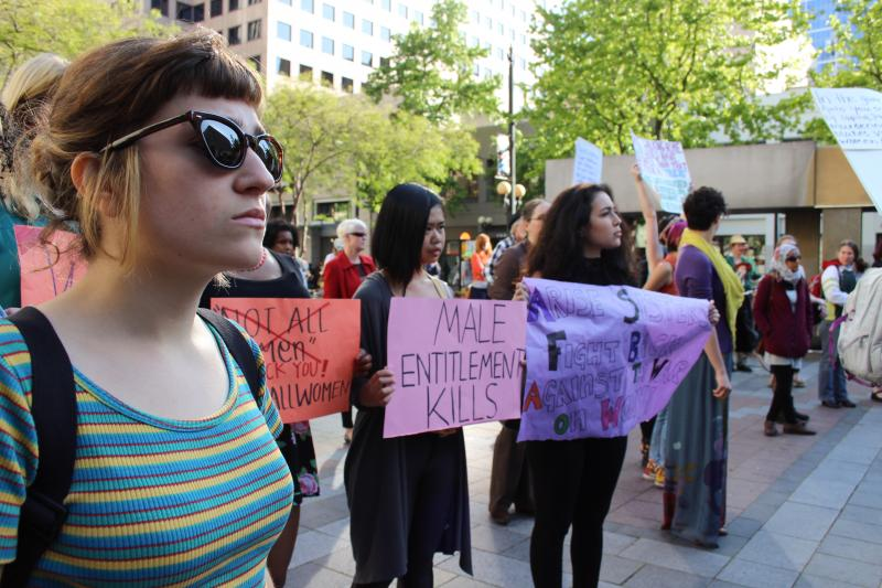 Alia Kusumaningrat, center, attended the #yesallwomen rally on Friday with friends from Seattle Central College. For Kusumaningrat, 18, the rally was part of finding words to describe the subtleties of sexism.