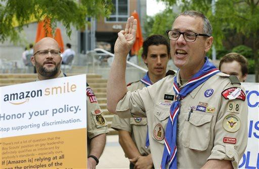 Geoffrey McGrath delivers a petition bearing more than 125,000 signatures, urging Amazon to stop donating money to the Boy Scouts on May 21, 2014.