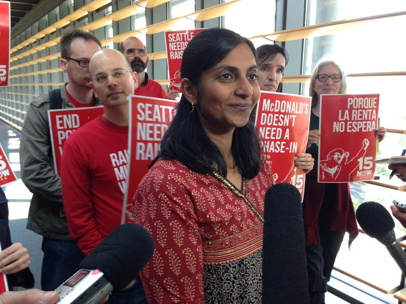 Seattle City Councilmember Kshama Sawant meets with reporters after the vote to phase-in a $15 minimum wage.
