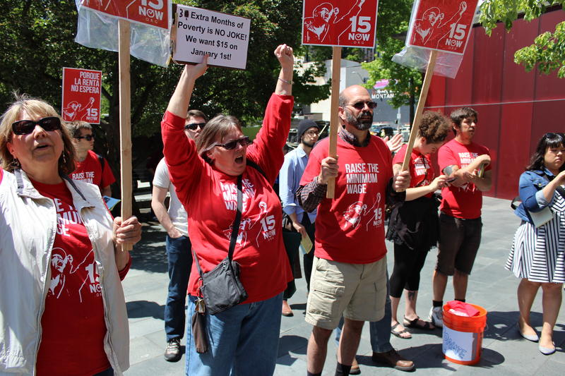 Linda Jansen and Doug Nielson rallying for $15 minimum wage outside City Hall on Monday. The Seattle City Council voted to pass the minimum wage bill unanimously.