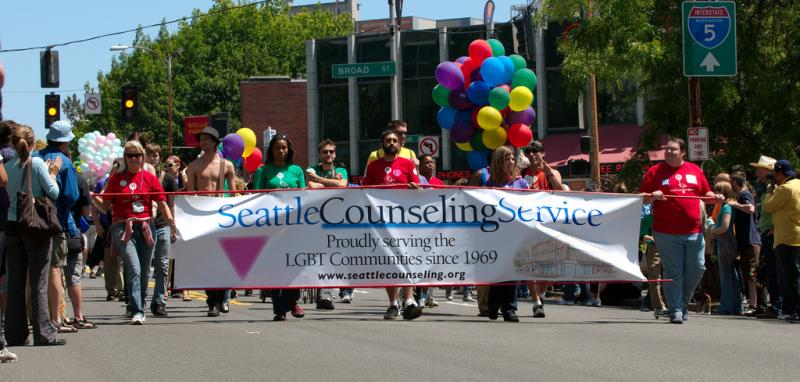 Representatives for Seattle Counseling Services at a Seattle gay pride event.