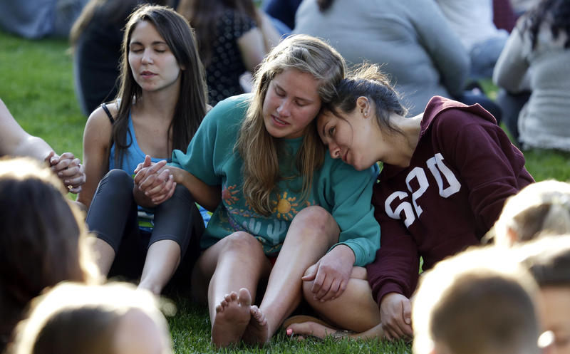 SPU students pray and comfort each other after last Thursday's campus shootings.