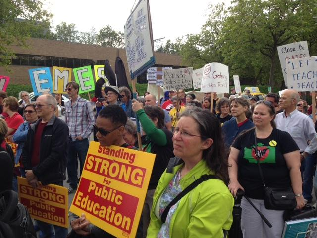 Teachers rally outside the Gates Foundation to demand changes to the organization's education strategies