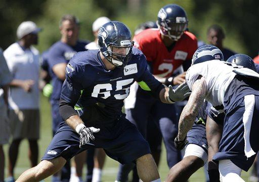 New Seattle Seahawks Eric Winston (65) moves to block at the line of scrimmage at an NFL football camp practice Tuesday.
