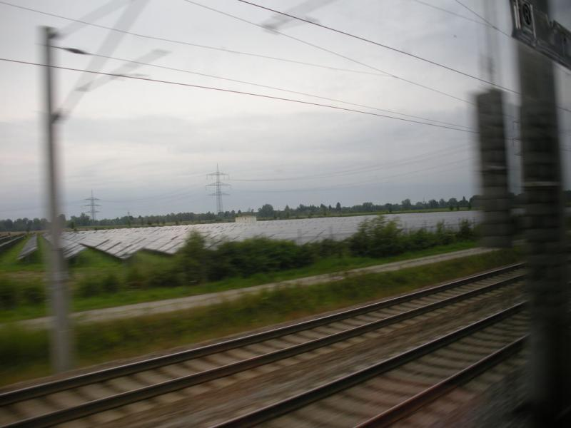 Solar panels in Bavaria seen from the window of a train.