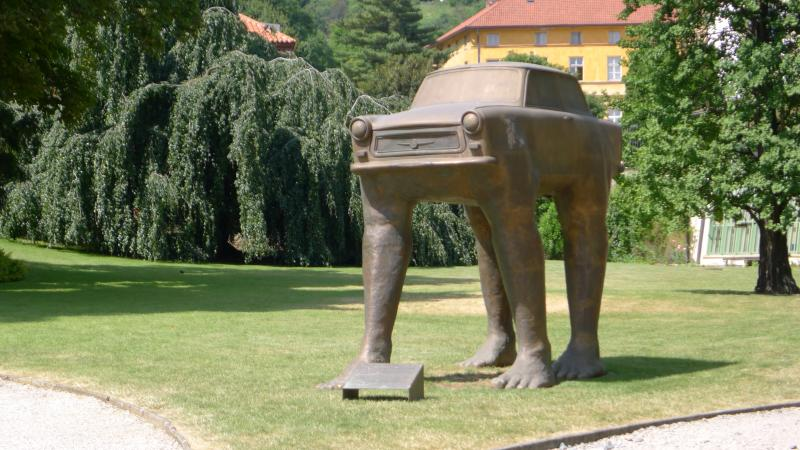 "David Cerny's sculpture ""Quo Vadis"" on the grounds of the German embassy in Prague. It commemorates the East Germans who came here to seeking asylum. The car is an East German-made Trabant. Many asylum seekers abandoned them on the streets."
