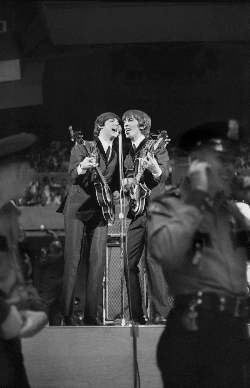 Paul McCartney and George Harrison at the Seattle Center Colisum, Aug. 21, 1964