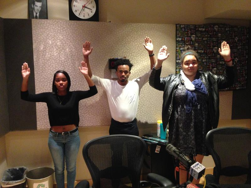 "Yaninna Sharpley-Travis (left), Marcel Purnell and Devan Rogers. They are making the ""don't shoot"" pose, which has become a popular form of social media protest after the events in Ferguson."