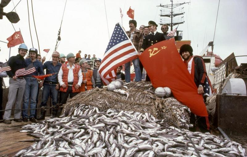 Soviet and U.S. fishermen celebrate good fishing on board a Soviet vessel (1983).