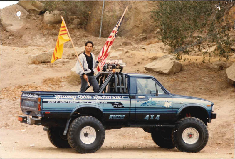 Quang Adam Nguyen, Angela's dad, holding the South Vietnamese and American flags.
