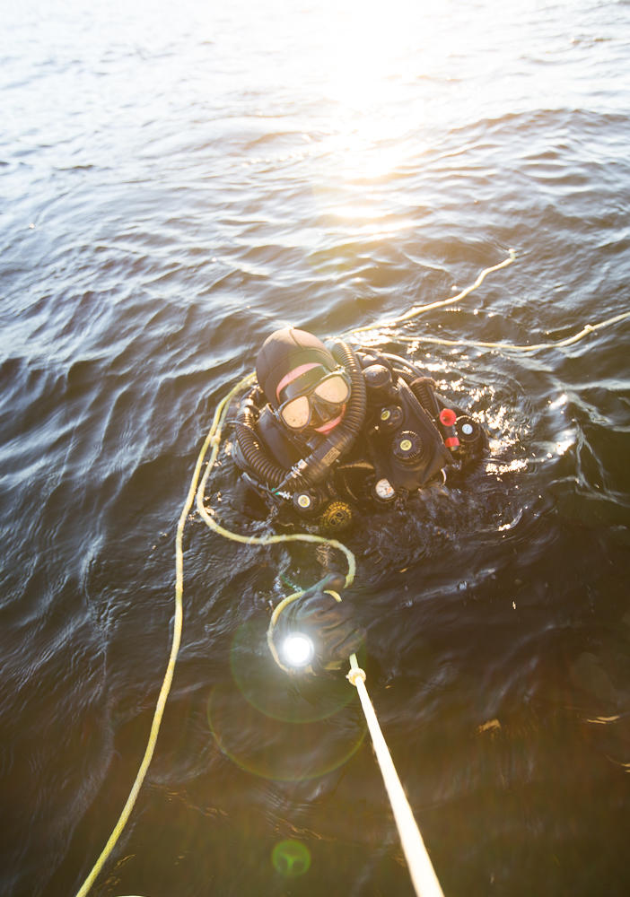 A small group of divers have been plunging into Lake Washington almost every week for the past eight years. They have found minesweepers so large they could swim through the corridors.