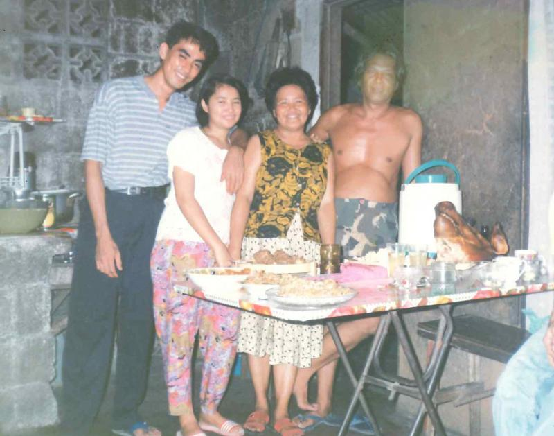 (From left) Maria's father, mother, grandmother, and grandfather at their home in Manila - the same home where they once encountered a supernatural creature. Maria learned about many traditional Filipino beliefs from her grandmother, Conchita Carpio.