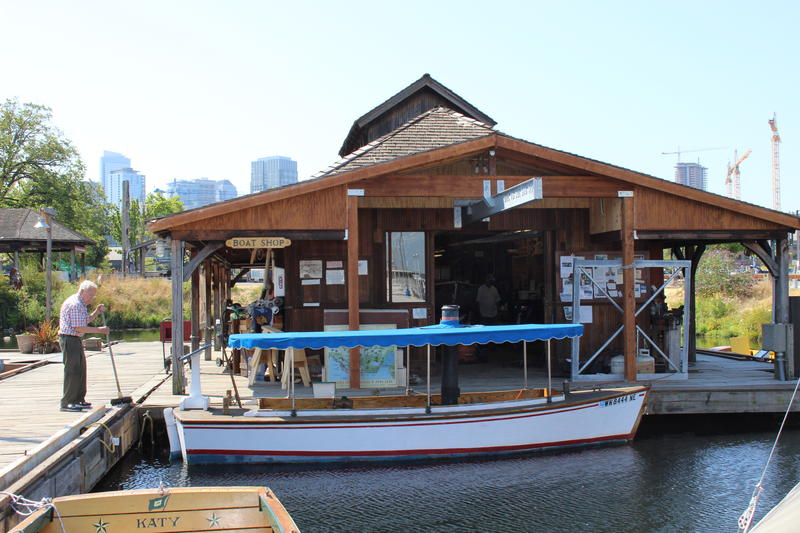 The growing buildings of the South Lake Union district rise behind the Center for Wooden Boats.