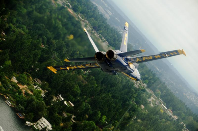 Lt. C.J. Simonsen, a solo pilot assigned to the U.S. Navy flight demonstration squadron, the Blue Angels, approaches from crowd right during the Seafair performance in 2011.