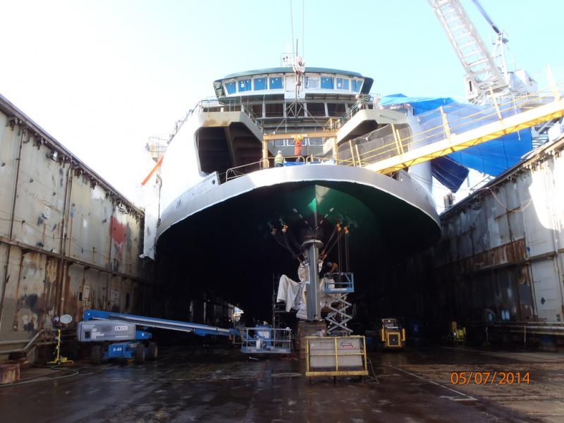 Crews prepare to paint the rudder on the M/V Samish in May of this year.