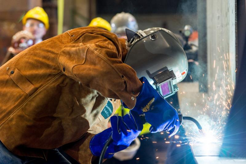 "Washington State Governor Jay Inslee welding the initials of his grandchild ""BRI"" at the keel laying ceremony for the state's newest ferry, the Samish, at Vigor Industrial Seattle shipyard in March 2013."