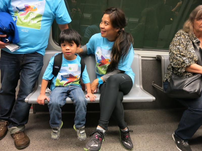 Christine Vega and her 5-year-old son Gibson ride the underground tram to get to their practice terminal.