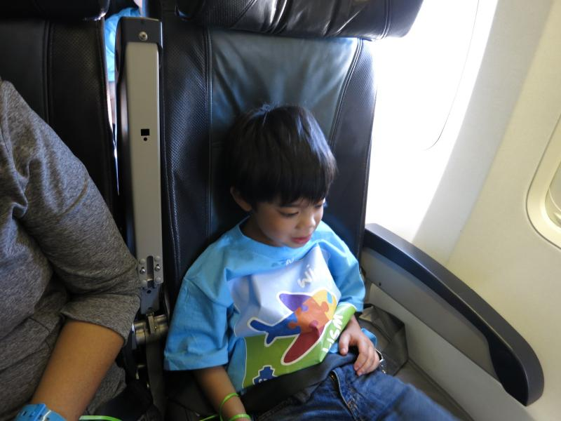 Gibson Vega, age 5, getting settled into his seat before the plane starts to taxi.