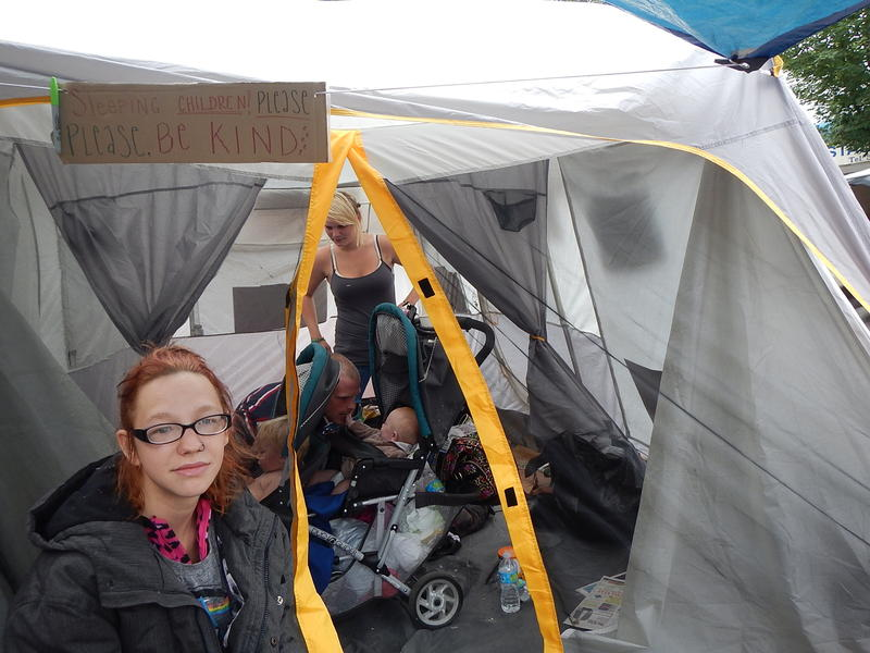 Jackie O'Bryan in front of her family's tent at the University District homeless camp.