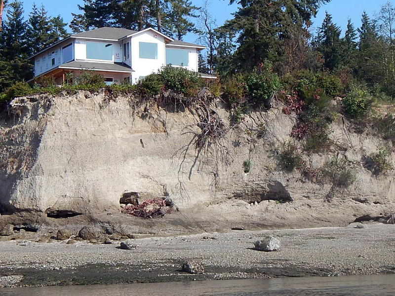 Home construction on an eroding bluff on south Puget Sound's Harstine Island, in Mason County