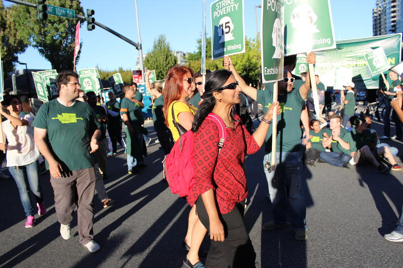 Socialist City Councilmember Kshama Sawant marches in Bellevue on Sept. 9, 2014. Labor activists are trying to spread the movement for a higher minimum wage to cities around Seattle.