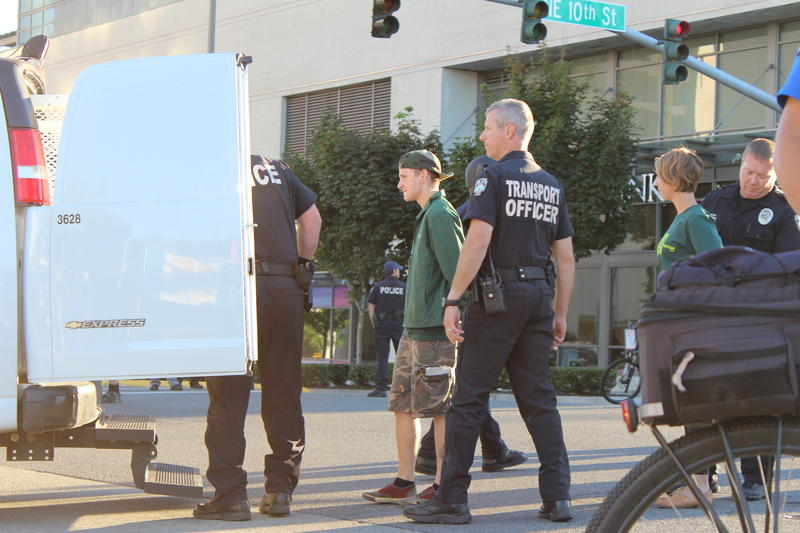 Bellevue police arrest eight protesters for failing to disperse from a busy intersection. The protesters, organized by the group Working Washington, had staged a day-long march for an increase in the minimum wage on Sept. 9, 2014.