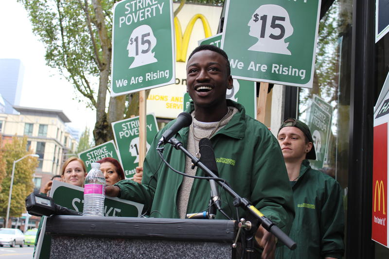 McDonald's employee Malcom Cooper-Suggs kicks off day-long march from Seattle to Bellevue for higher wages, organized by Working Washington, on Sept. 9, 2014.