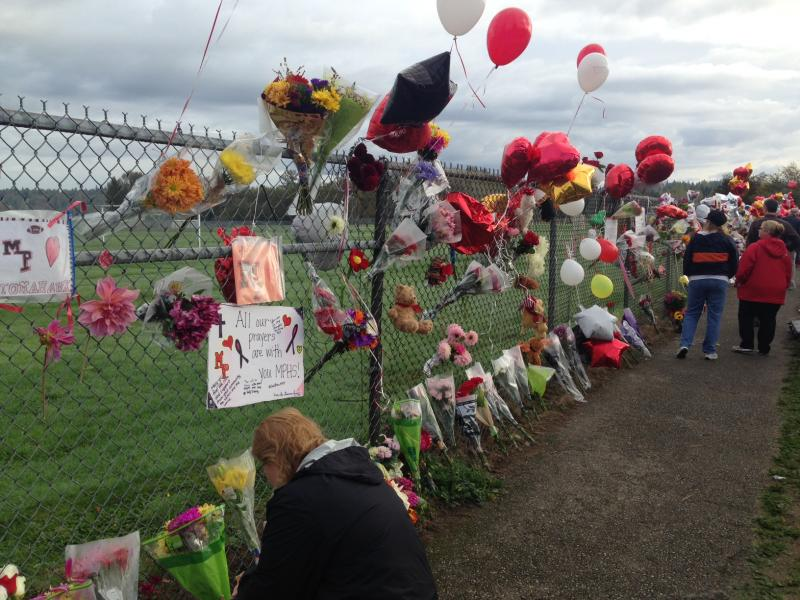 Balloons and flowers at an impromptu memorial at Marysville Pilchuck High School the Monday after a school shooting on Friday, Oct. 24.