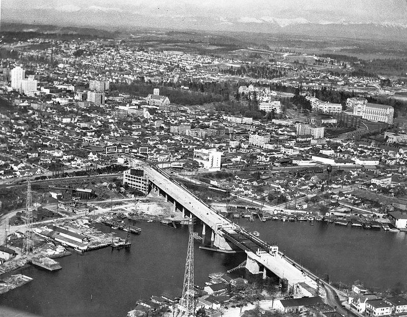 In 1933, the University Bridge was under construction. In a couple of years, the district will have a Sound Transit train running through to downtown Seattle.