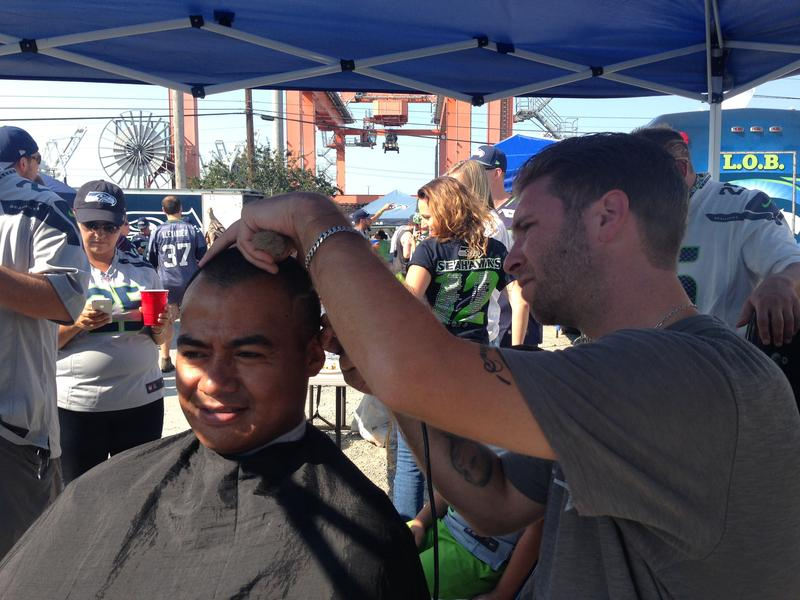 Jason Fox shaves the Seahawks logo into a loyal 12's hair.