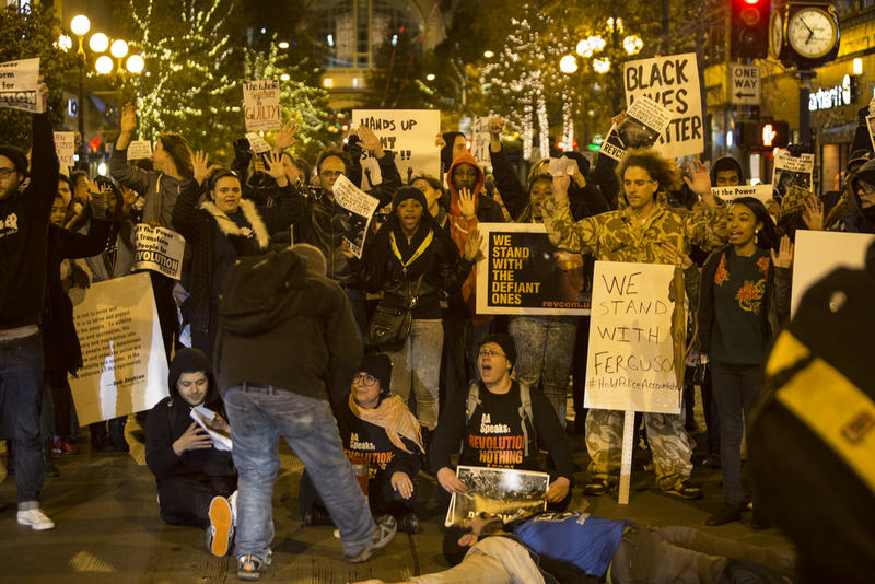 On Monday night, protesters in Seattle decried the the lack of indictment for St. Louis police officer Darren Wilson, who shot and killed Michael Brown.