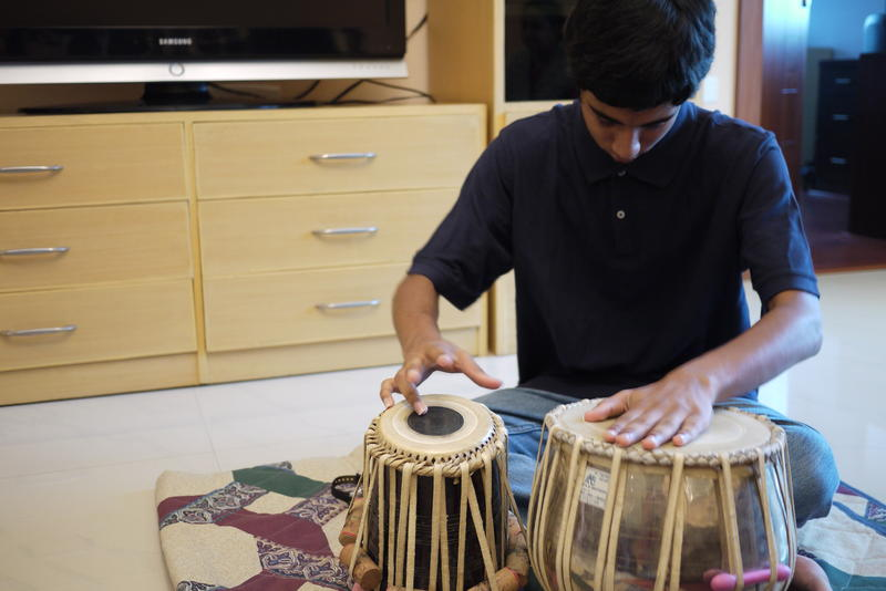 Apurva Koti, 16, plays tabla drums in his living room in Hyderabad, India.  Apurva also plays electric guitar. Apurva and his family moved to India from Redmond, Washington in 2008.